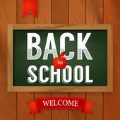 Back to school poster with text on chalkboard on wooden background. — Stock Vector