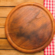 Bread board on wooden background with tablecloth — Stock Photo