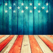 Stock Photo: Empty wooden deck table over USflag background.