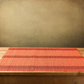 Bamboo tablecloth on wooden table over grunge background — Stock Photo