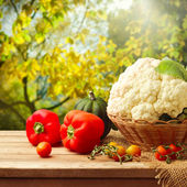 Fresh vegetables on wooden table — Stock Photo