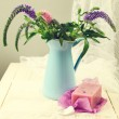 Flower bouquet with handmade lavender soap — Stock Photo