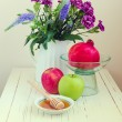 Stock Photo: Apple with honey, pomegranate and flowers
