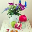 Stock Photo: Honey, apple, pomegranate and flowers on wooden white table