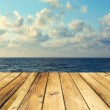 Wooden deck floor over beautiful seand sky background — Stock Photo #30172541
