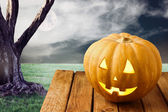 Halloween pumpkin over dramatic background — Stock Photo