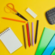School suplies on yellow background. — Stock Photo