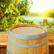 Wooden barrel over vineyard background. — Stock Photo