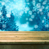 Winter background with wooden table — Stock Photo