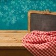 Winter background with chalkboard — Stock Photo