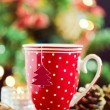 Tea cup with paper Christmas tree — Stock Photo #34165953