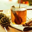 Hot Christmas drink on wooden tray — Stock Photo