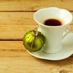 Coffee cup with christmas ball — Stock Photo #34920631