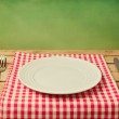 Empty plate with knife and fork — Stock Photo