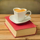 Coffee cup on book — Stock Photo