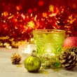 Stock Photo: Candle glass with Christmas ornaments