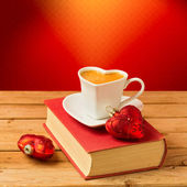 Coffee cup on book with Christmas decorations — Stock Photo