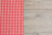Table with red checked tablecloth. — Stock Photo