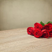 Romantic background with red roses — Stock Photo