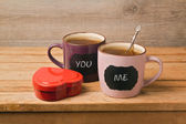 Tea cups with chalkboard stickers — Stock Photo