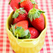 Fresh strawberry on checked tablecloth — Stock Photo #38230281