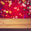 Stock Photo: Deck table over festive bokeh background