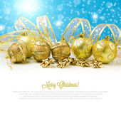 Christmas golden balls and baubles — Stock Photo