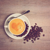 Coffee cup with heart shape — Stock Photo