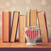 Valentine's day cup with books — Stock Photo