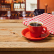 Coffee cup with checked tablecloth — Stock Photo #39495663