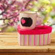 Cup of tea with heart shape and gift box — Stock Photo