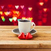 Coffee cup with heart shape chocolate — Stock Photo