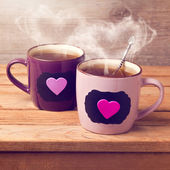 Cup of tea with chalkboard stickers — Stock Photo