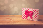 Gift box with heart shape — Stock Photo