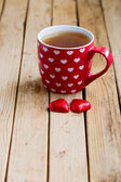 Tea cup and chocolate for Valentine's day — Stock Photo