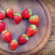 Strawberries with heart shape — Stock Photo