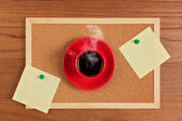 Coffee cup and board with notes — Stock Photo