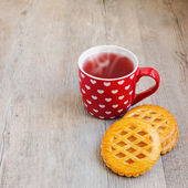 Tea cup and cookies — Stock Photo