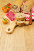 Bread with sliced meat sausage — Stock Photo