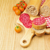 Sandwich with sliced meat sausage — Stock Photo