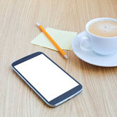 Modern workplace with mobile phone — Stock Photo