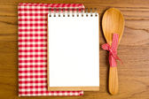 Blank note book with wooden spoon — Stock Photo