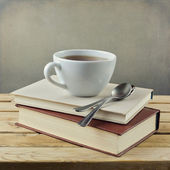 Cup of tea on vintage books — Stock Photo