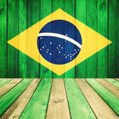 Wooden background with flag of Brasil — Stock Photo