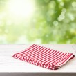 Background with wooden table and tablecloth — Stock Photo
