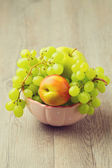 Healthy fruits in bowl — Stock Photo