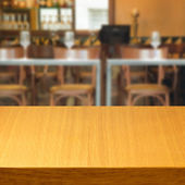 Empty wooden table inside restaurant — Stock Photo