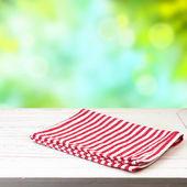 Empty wooden table and tablecloth — Stock Photo
