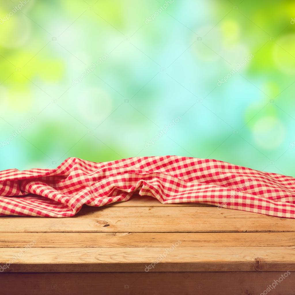 Empty wooden deck table with tablecloth — Stock Photo ...