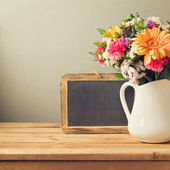 Flower bouquet and chalkboard — Stock Photo